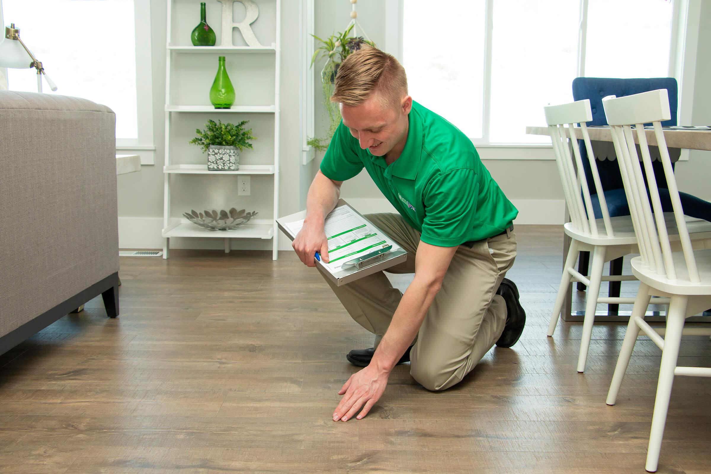A Chem-Dry technician inspecting a wood floor